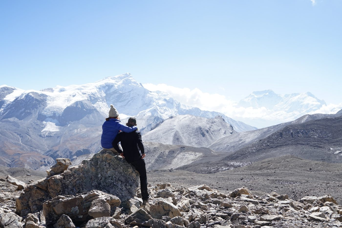 Romantic Getaway: Couple looking at the mountains