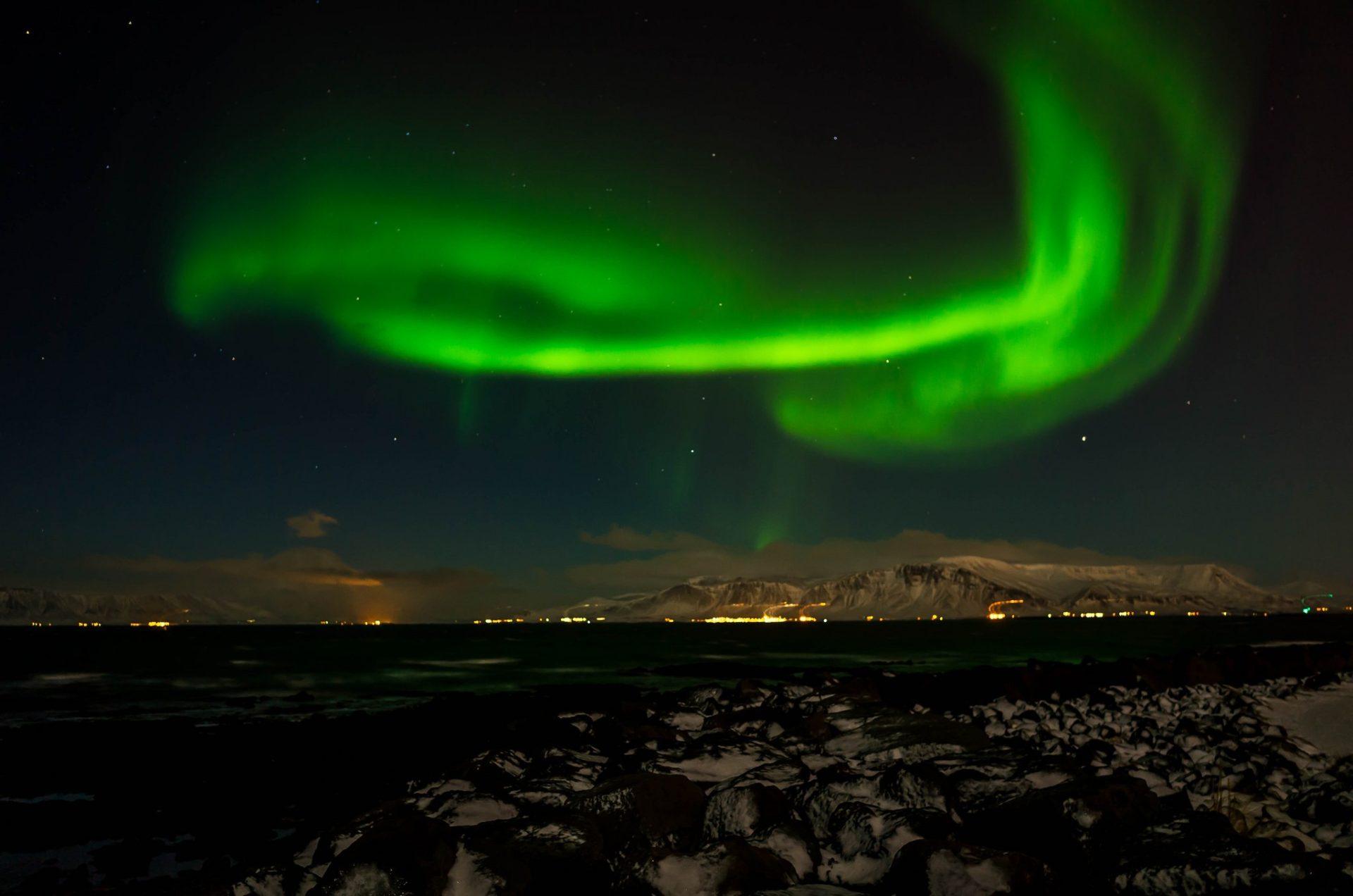 Northern Lights over Reykjavik. Photo by Serge via Flickr CC, bucket list ideas
