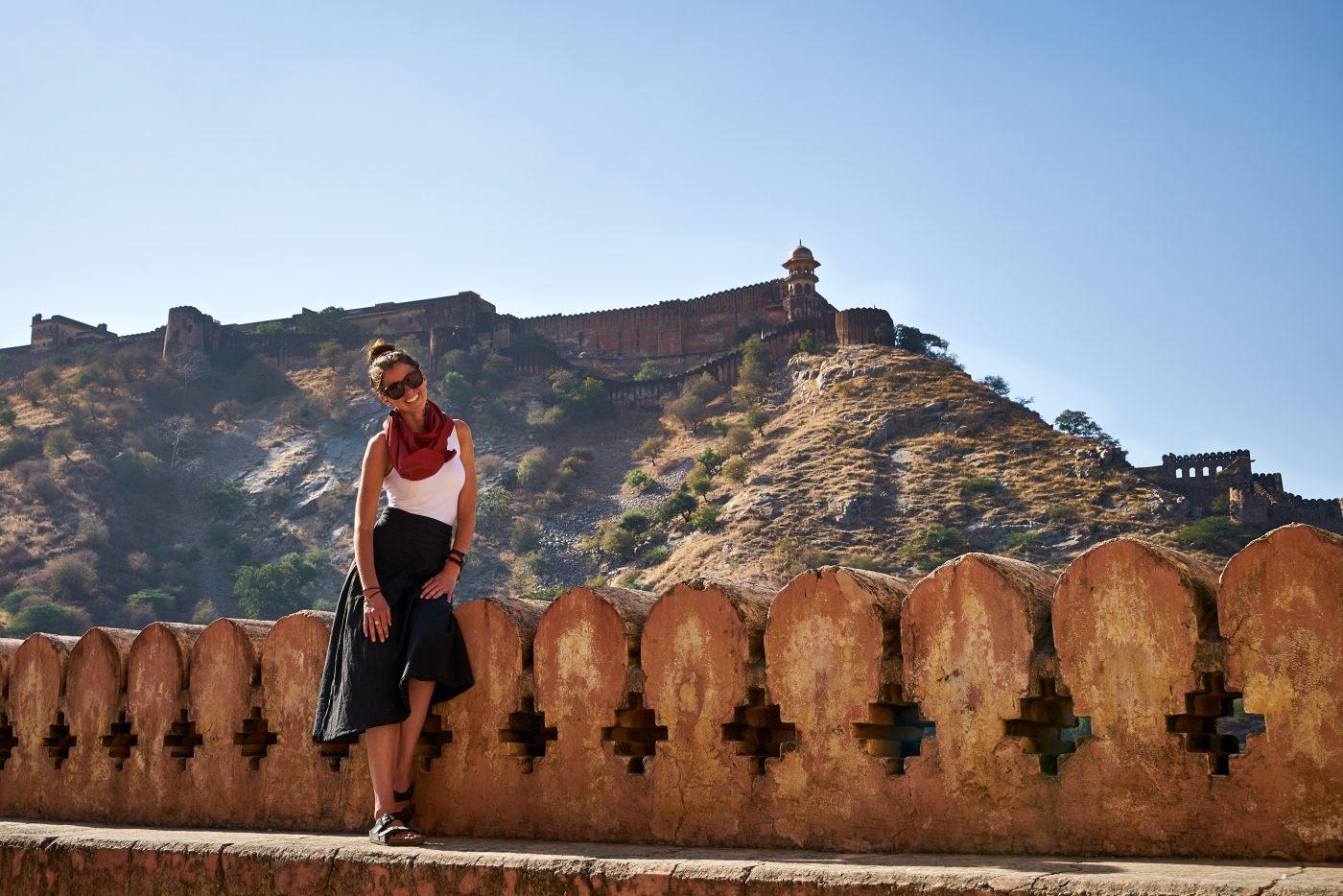 Romantic Getaway: Girl standing in front of mountain
