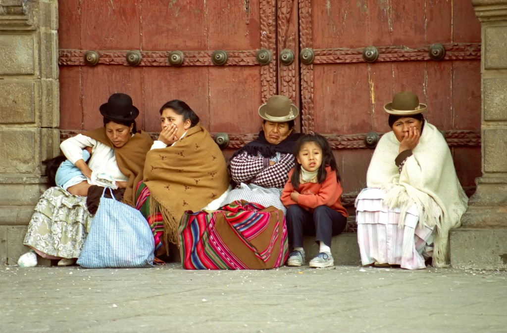 Women and children around the Cathedral dressed in traditional clothes. La Paz, Bolivia. Photo by Dennis Jarvis via Flickr CC