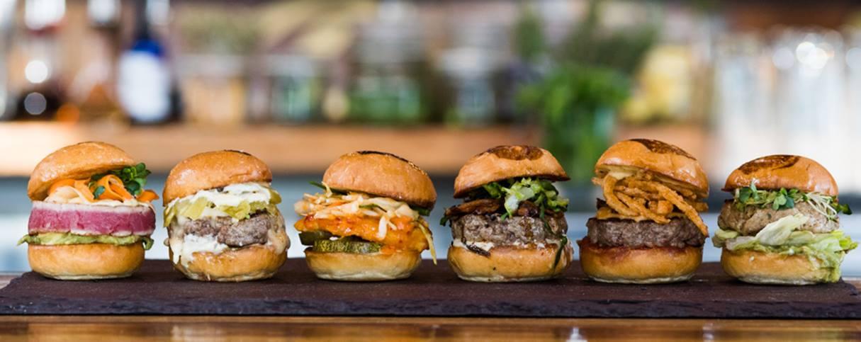Burgers at Unami Burger, Hudson Hotel, New York. Photo via Hudson Hotel
