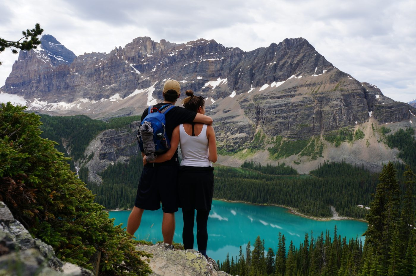 Saving money for travel: Couple looking at mountain