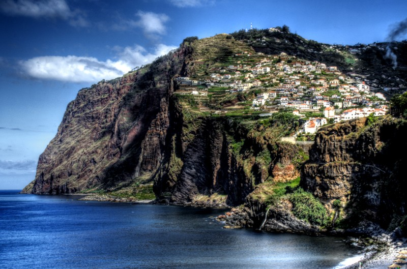 Clifs at Camar de Lobos town, in Madeira island southern coast. Portugal. Photo Credit: Flickr CC J. A. Alcaide
