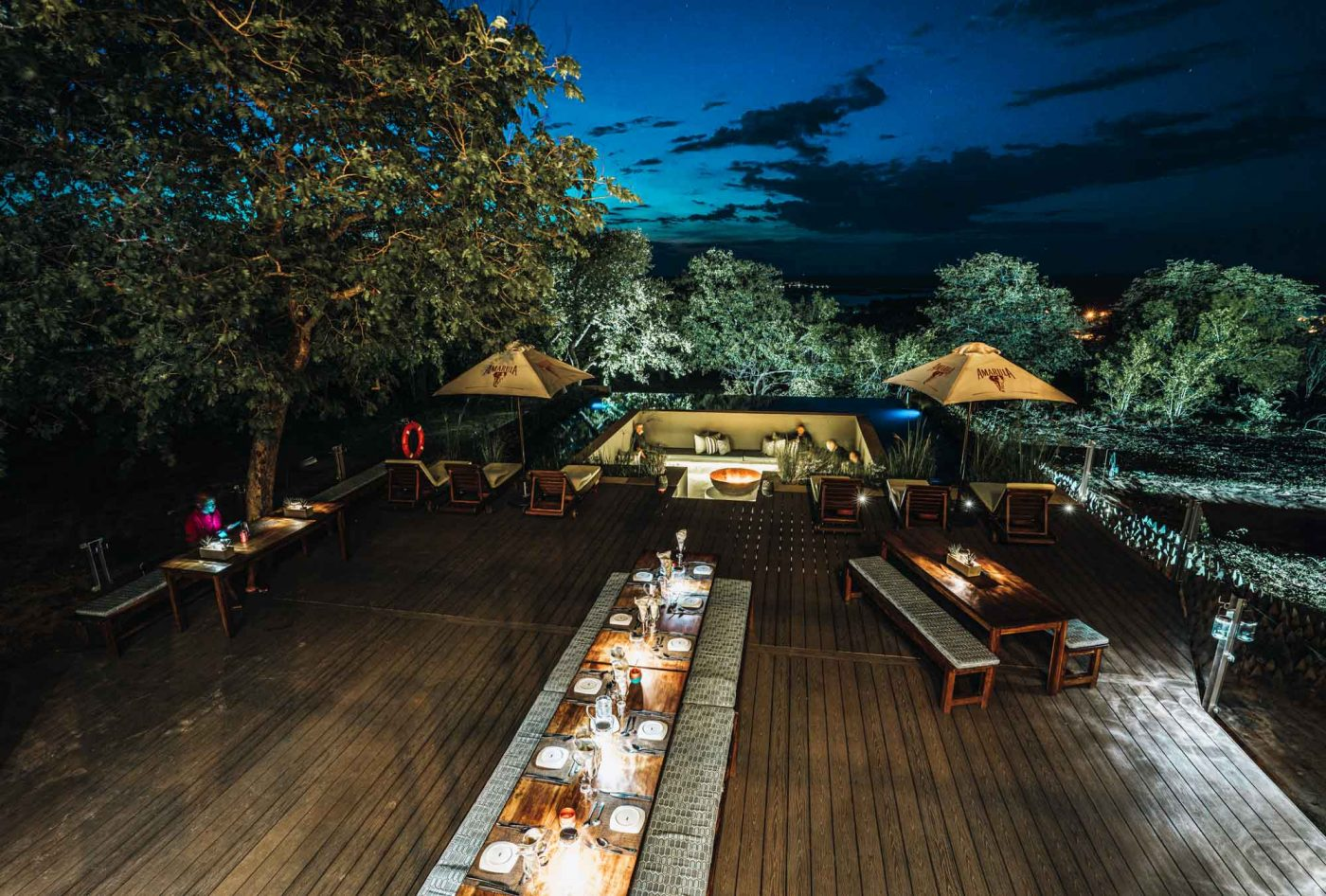 Evening fireside chats at Pangolin Chobe Hotel