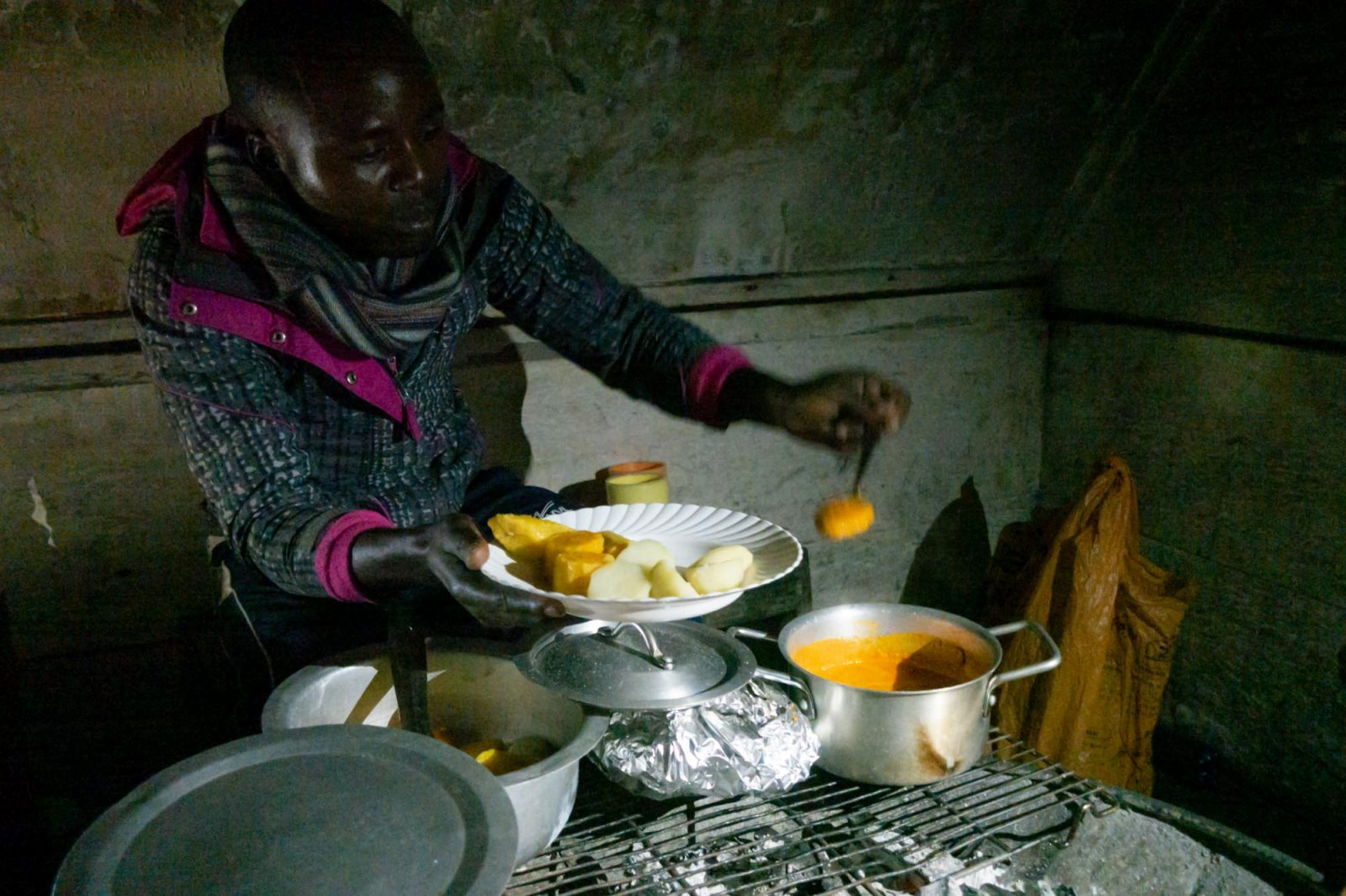 our local cook, making us dinner on Nyiragongo Volcano Trek