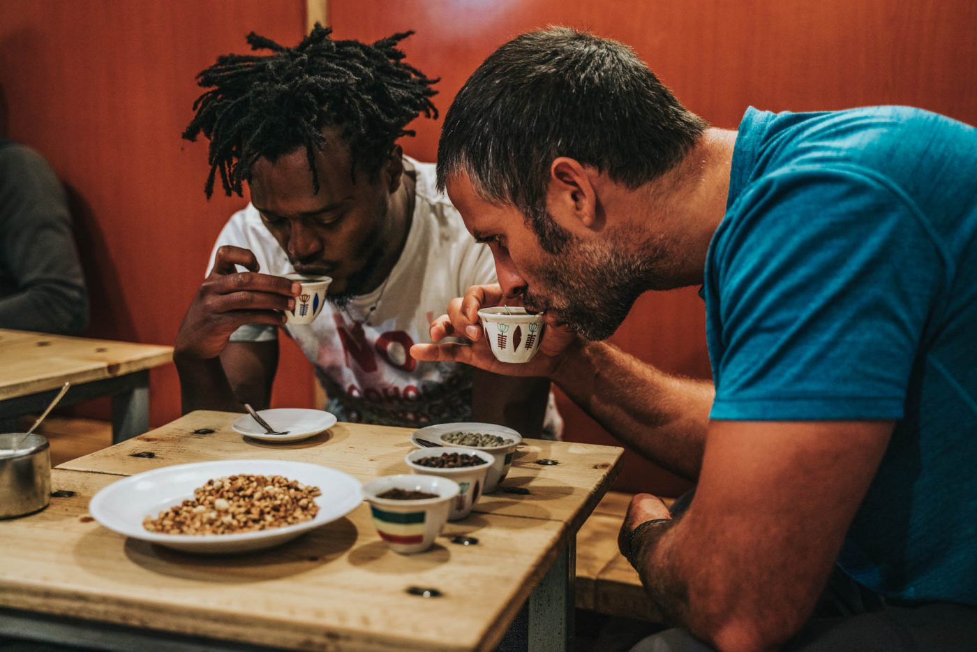 Local guide teaching Max the art of drinking coffee in Addis Ababa