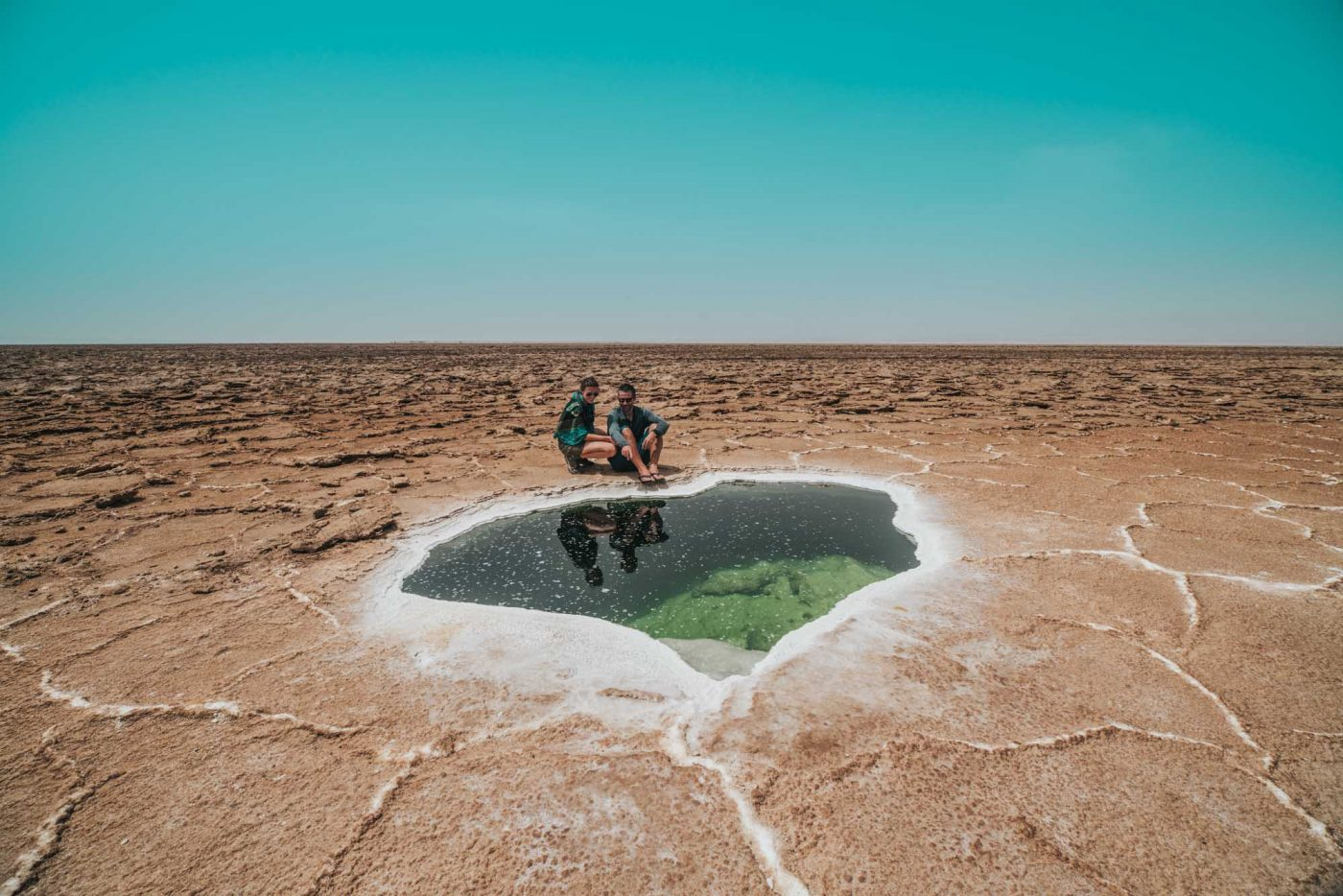 Admiring a small salt lake amidst the arid landscape of Dallol region in Danakil Depression
