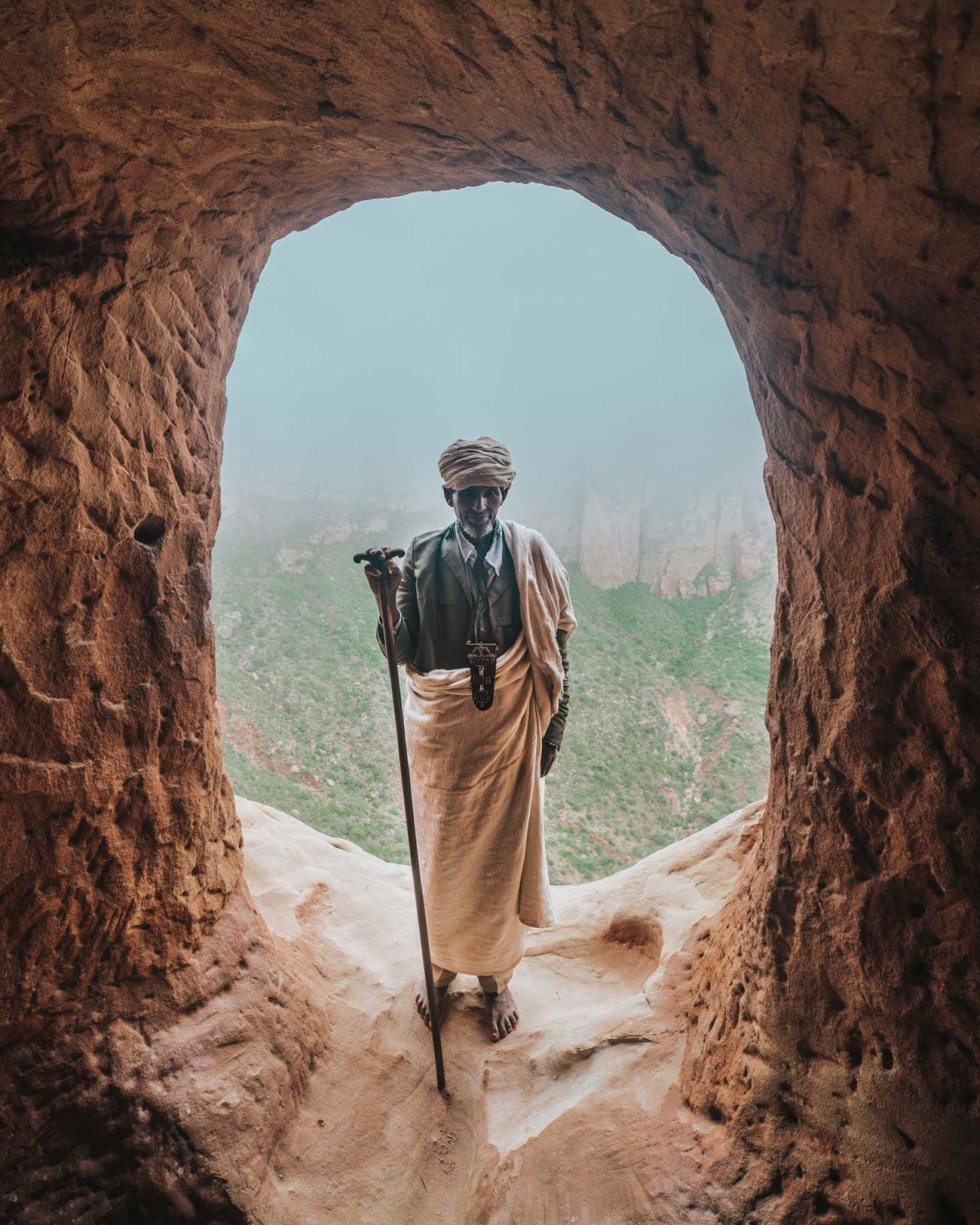 Priest inside Abuna Yemata Guh Church, Gheralta, Tigray Region