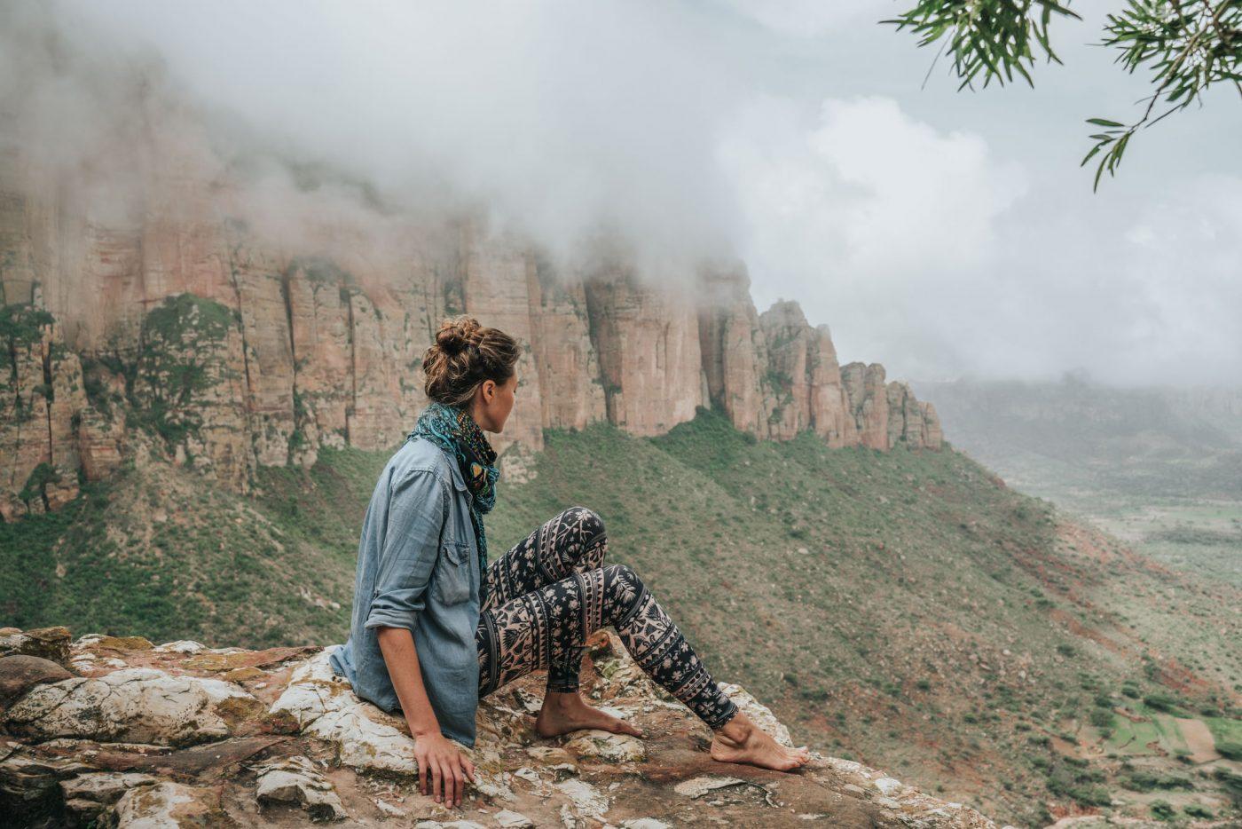 Oksana wearing Teeki yoga pants, an eco friendly gift, while hiking in Ethiopia