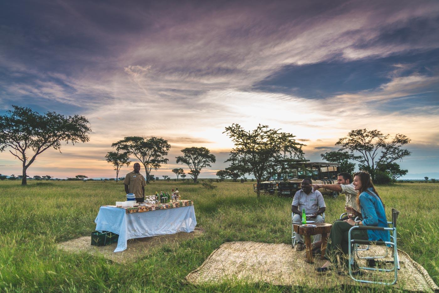 Sundowner on a safari with Ishasha Wilderness Camp in Queen Elizabeth National Park