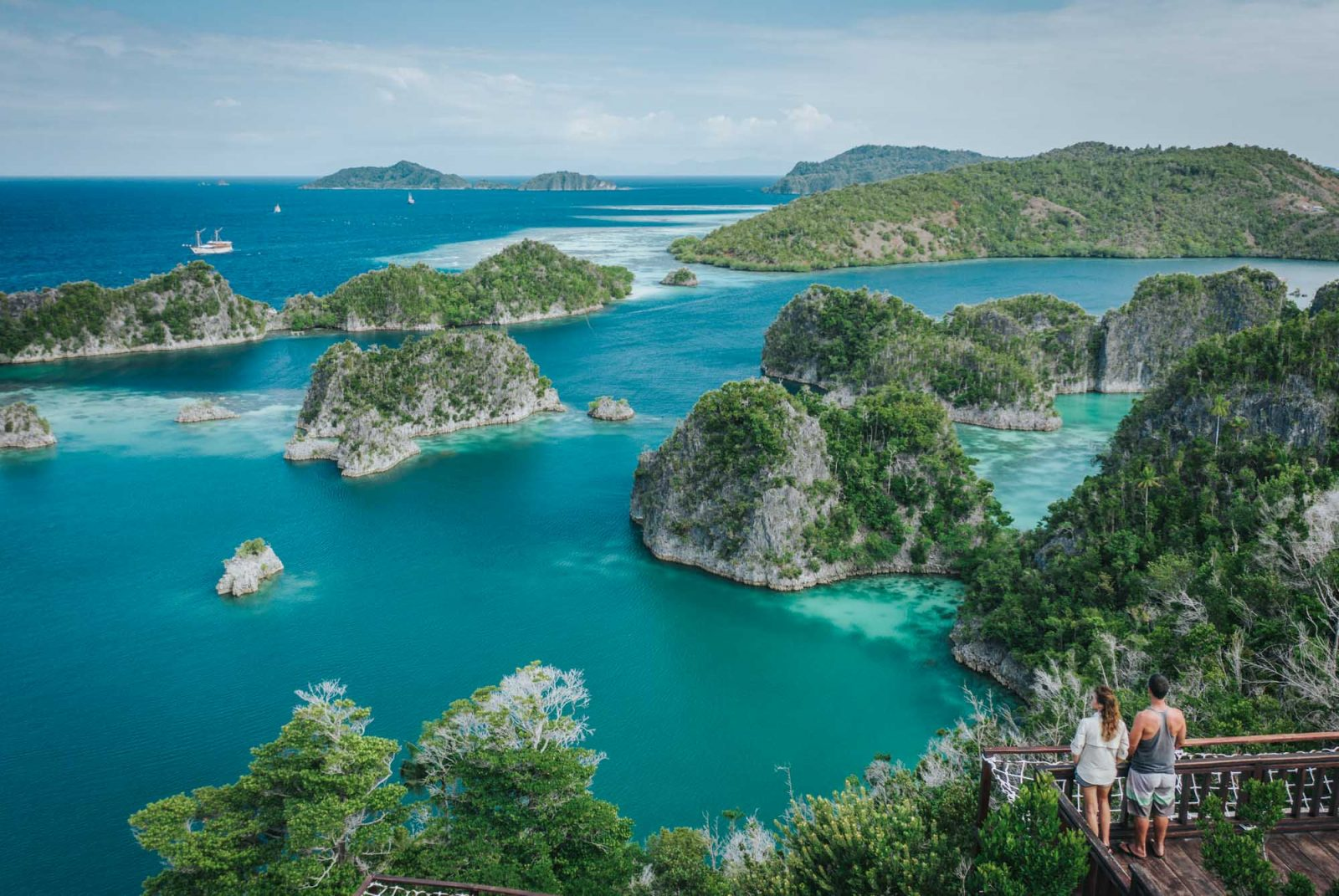 Overlooking the islands of Raja Ampat, Indonesia, off the grid vacation