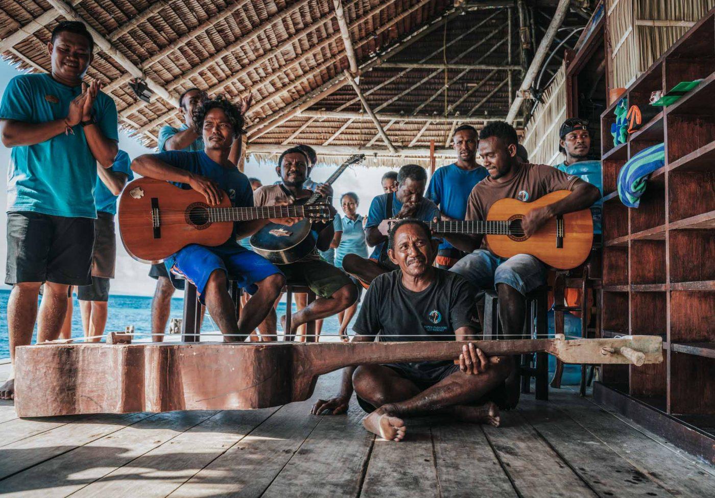 Staff jams at Papua Paradise Eco Resort, raja Ampat, Indonesia