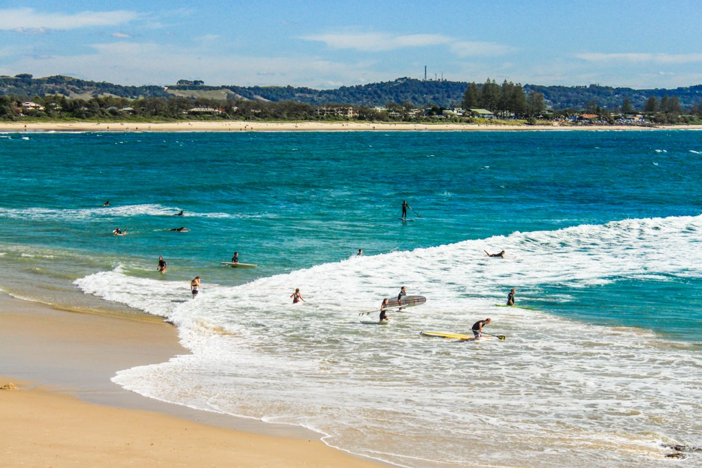 Surfers crowd the beach in Byron Bay, New South Wales