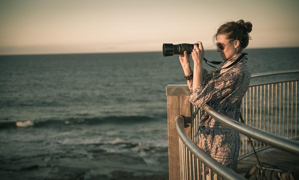 Oksana with camera in Newcastle. Australia