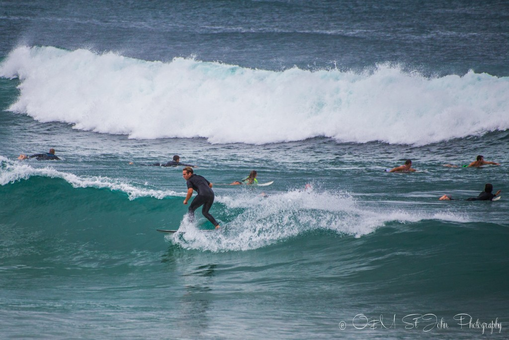 Trip to Australia cost: Surfers on Towns Beach, Port Macquarie, NSW