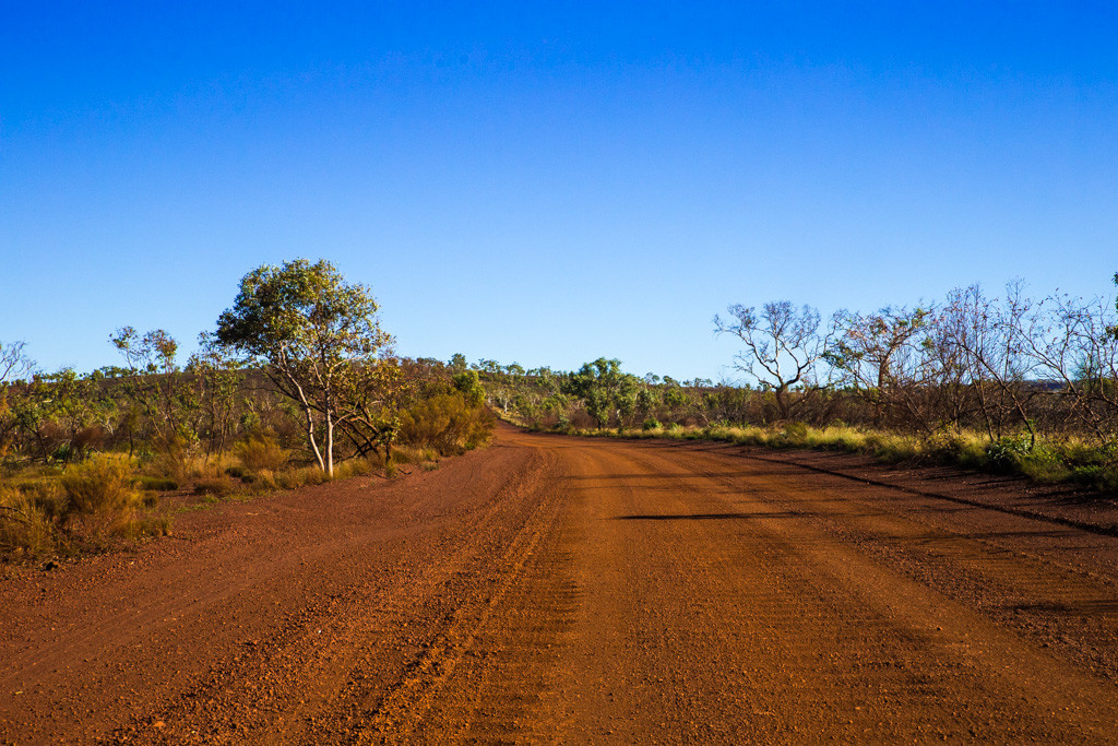 Western Australia itinerary: Unsealed red dirt road leading up to Karijini National Park. Western Australia