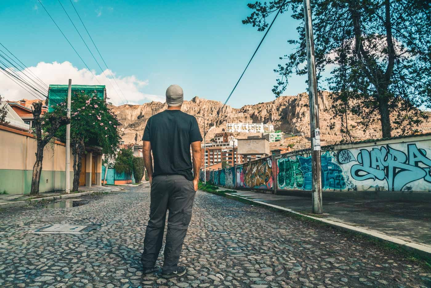 Max wearing his Unbound t-shirt for the eco friendly gift guide while exploring La Paz, Bolivia