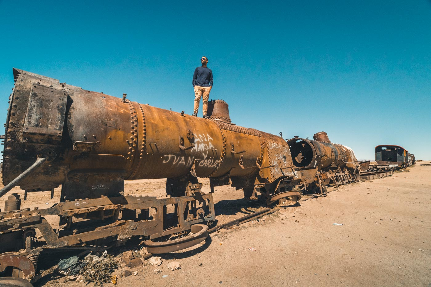 Max on top of a rusted train at the Train Graveyard outside of Uyuni