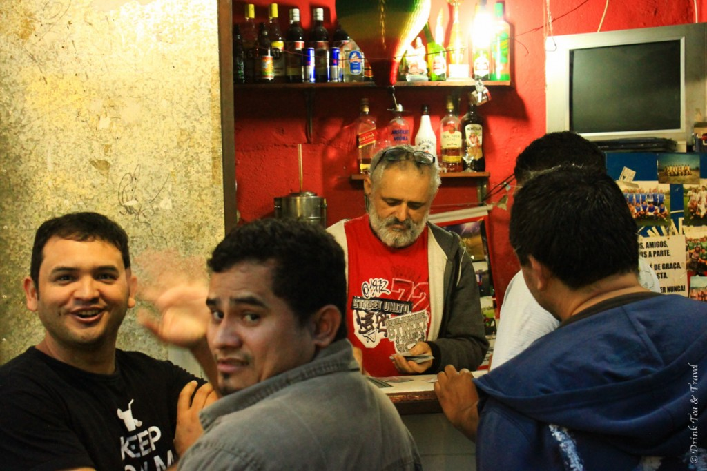 Local men playing cards in a small bar in Rocinha, largest favela in Rio de Janeiro