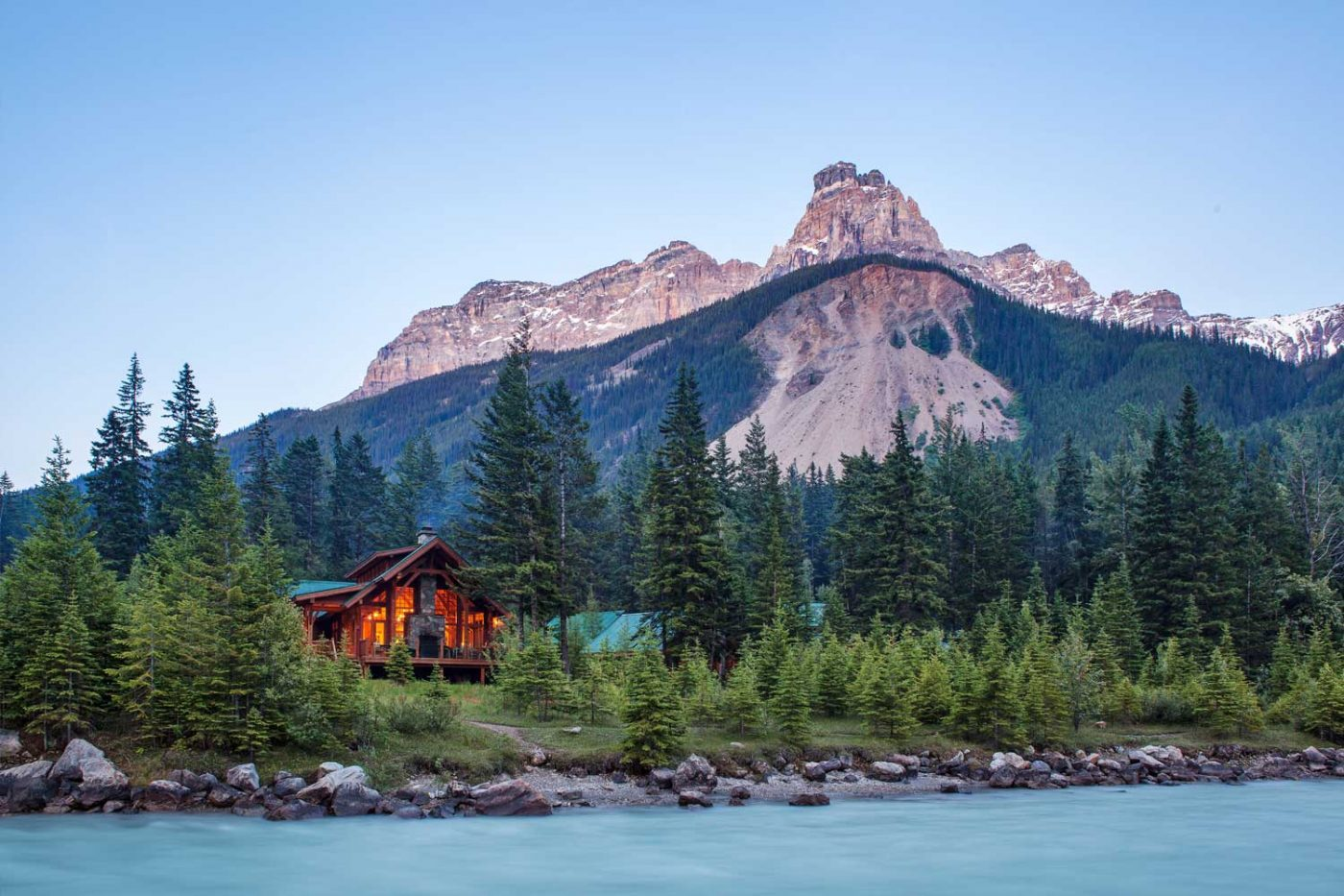 luxury resorts in british columbia: Cathedral Mountain Lodge mountains in the background