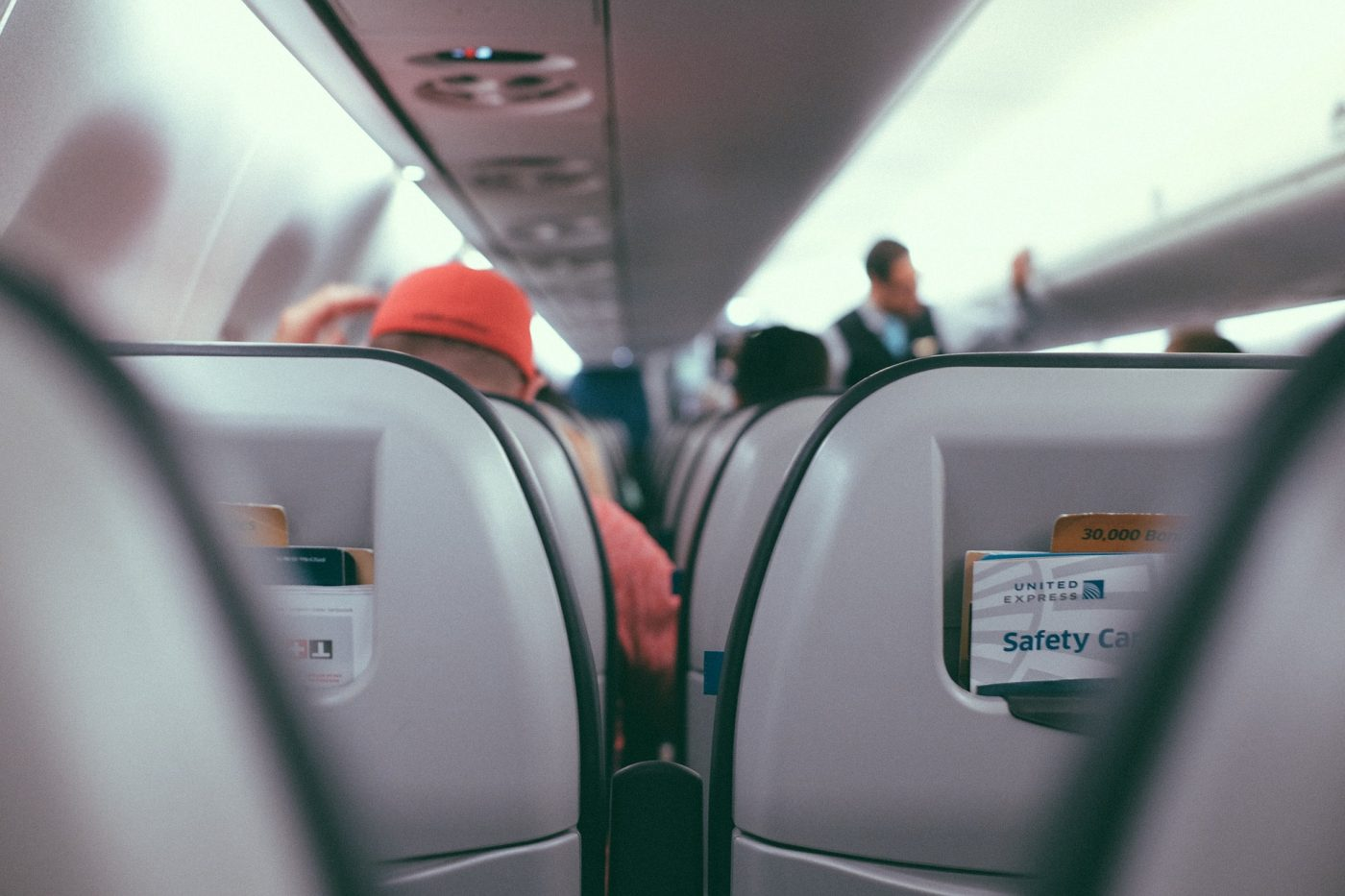 carbon offset progams, https://pixabay.com/photos/inside-airplane-airline-travel-2601081/
