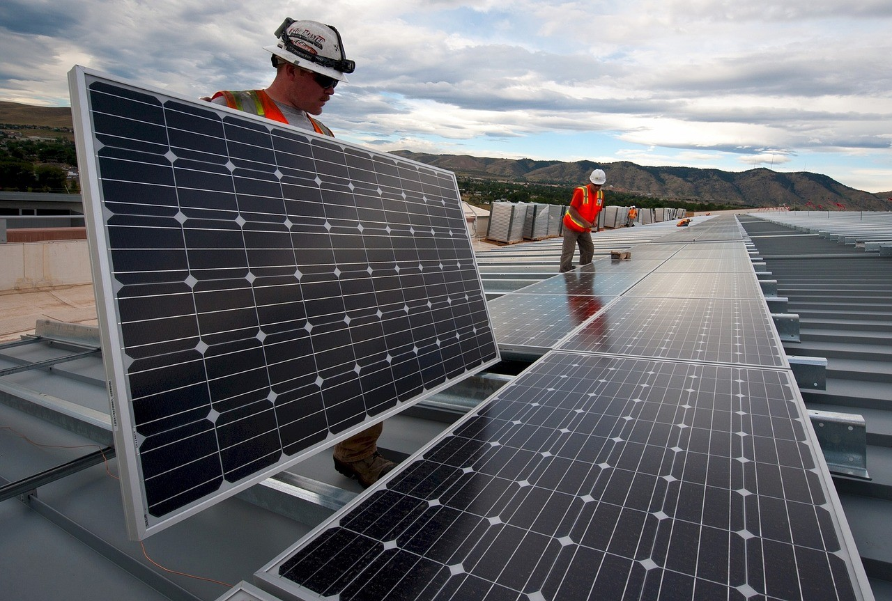 Carbon Offset Programs - https://pixabay.com/photos/solar-panels-installation-workers-1794467/