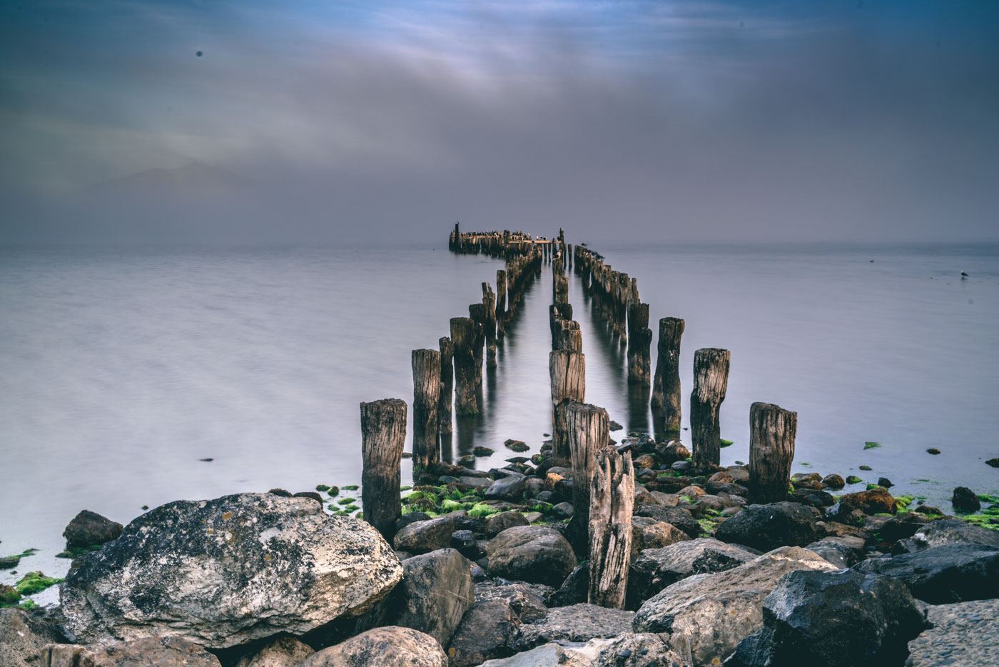 Old wooden pier on a foggy morning in Puerto Natales, Patagonia, Chile