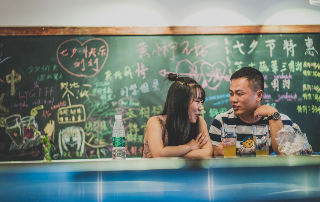 Young couple at a restaurant in Chengdu, China