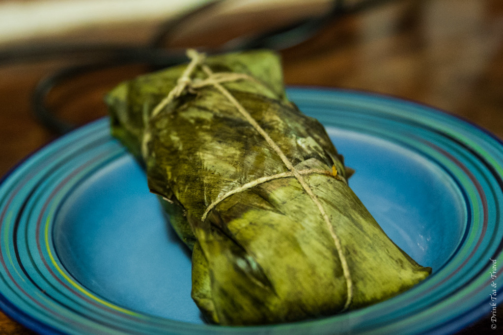 Costa Rican Food: Costa Rican Tamale served in the banana leaf wrap.