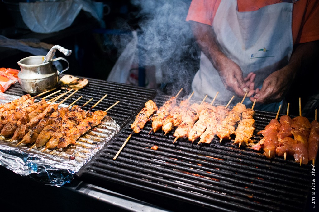 what to do in tamarindo costa rica: Pollo and Carne Asada on the grill in Tamarindo Market