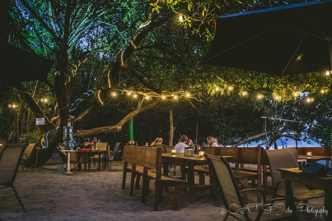 Tables on the beach restaurant Lo Que Hay. Samara Costa Rica