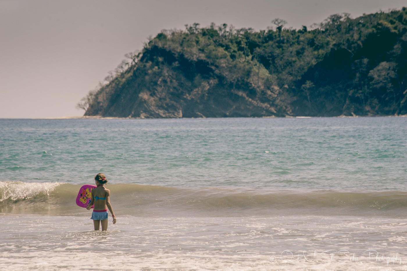 Little girl playing in the water on Playa Samara Costa Rica