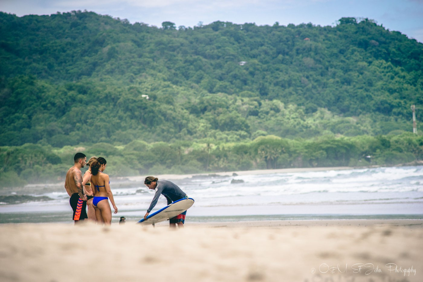 Surf lesson on the beach in Santa Teresa. Costa Rica