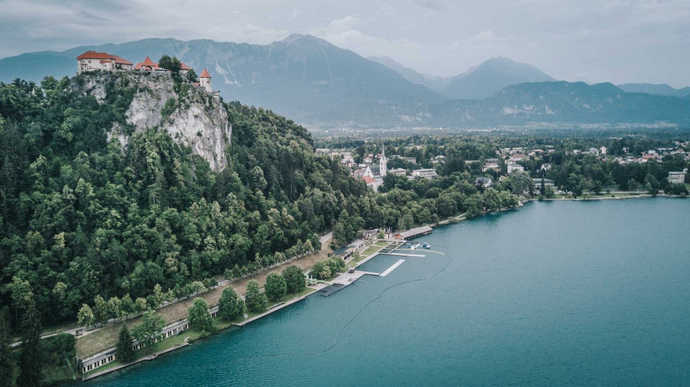 Fairytale setting of Lake Bled castle perched on top of the hill. Slovenia