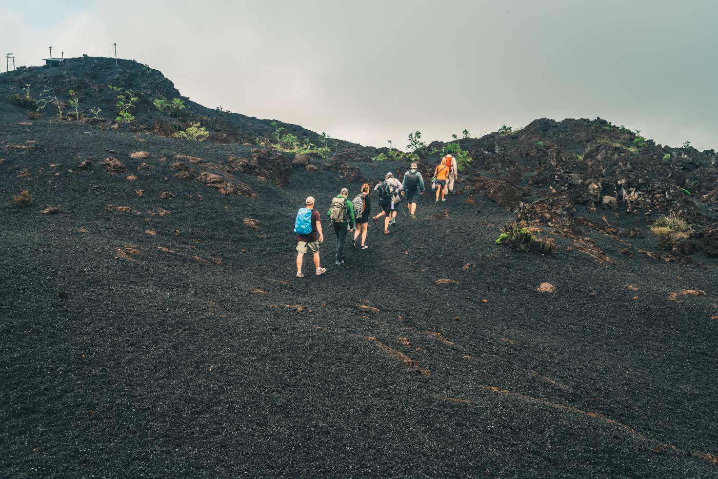 Hiking on Cerro Negro volcano on Isabela Island, Galapagos