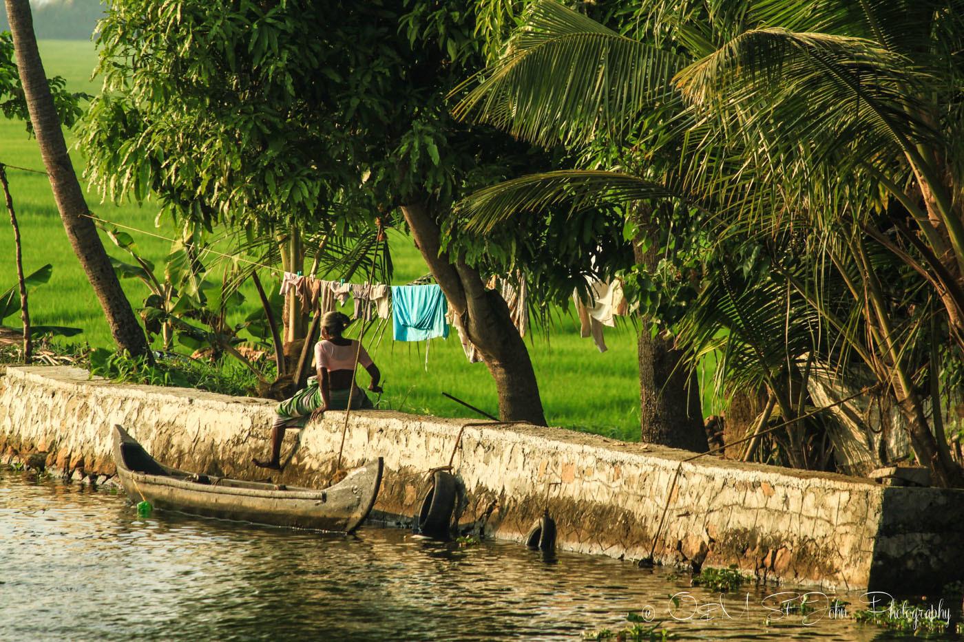 Local in small boat. Kerala Backwaters. India