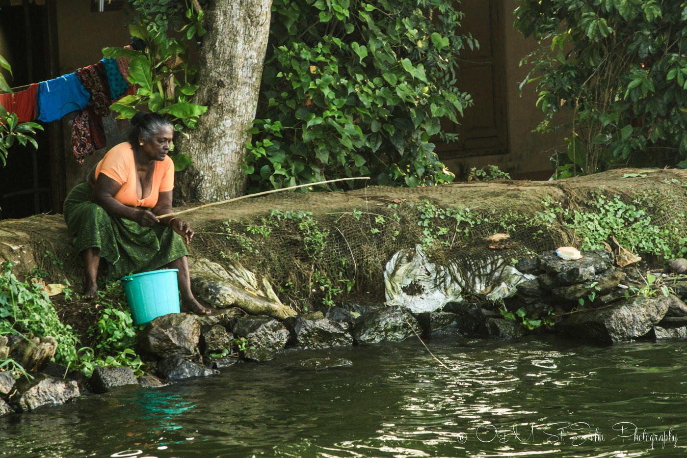 Woman fishing in the river. Kerala Backwaters. India