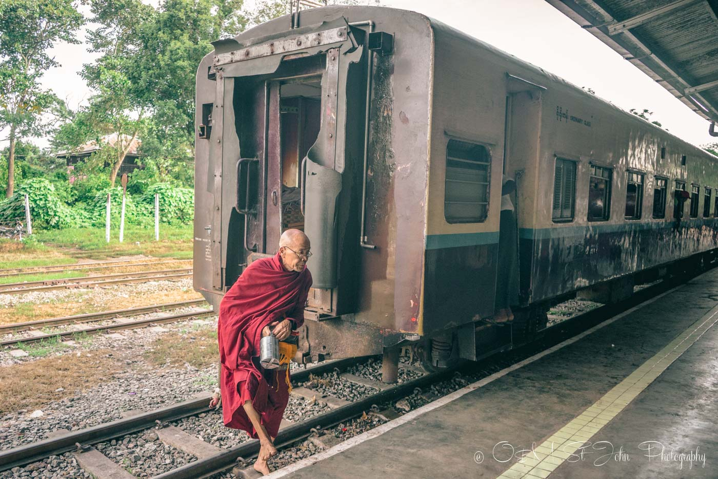 Burmese monk crossing the train tracks. Myanmar