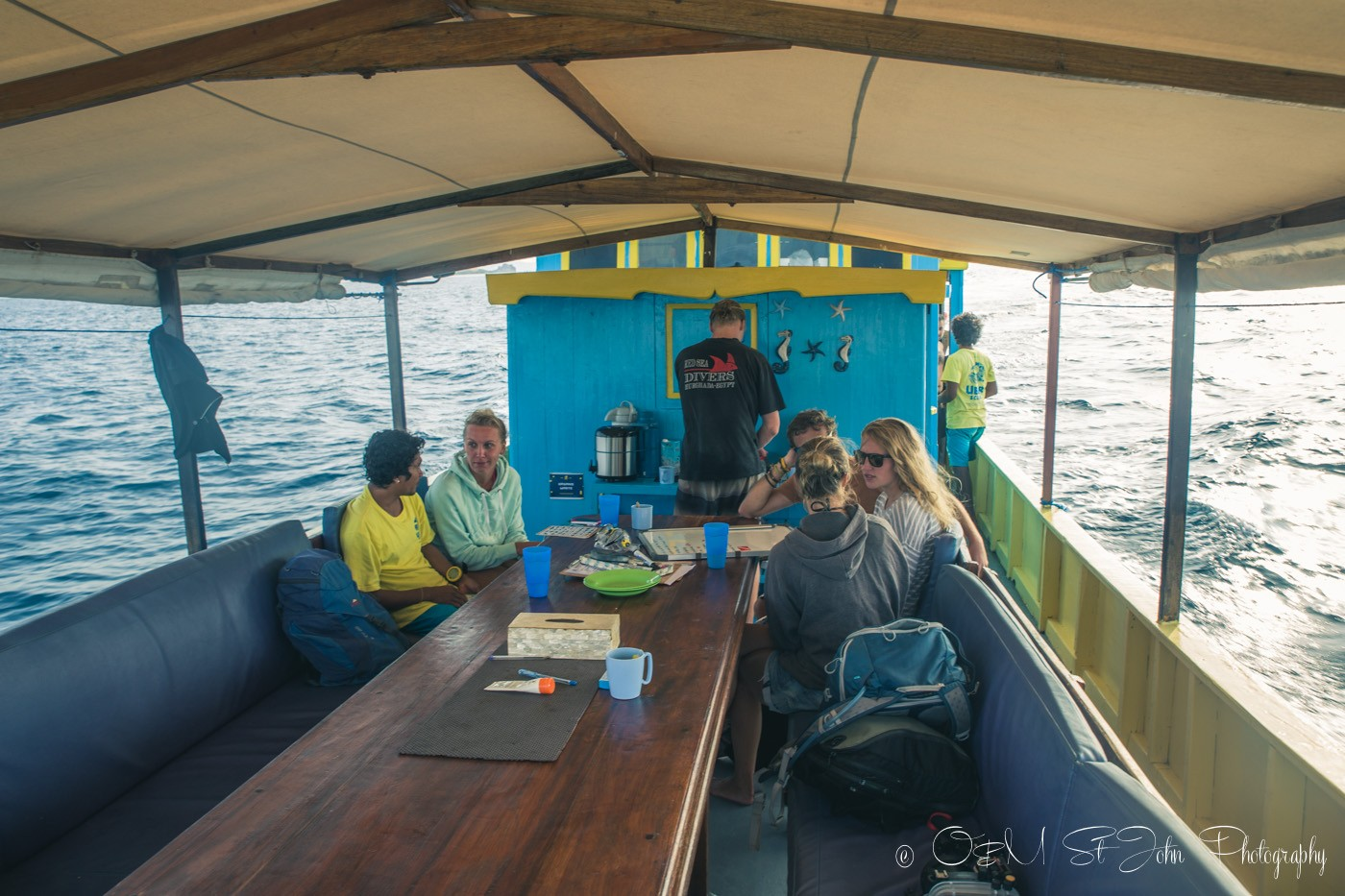 Divers chatting away on board Uber Scuba Komodo Day Boat
