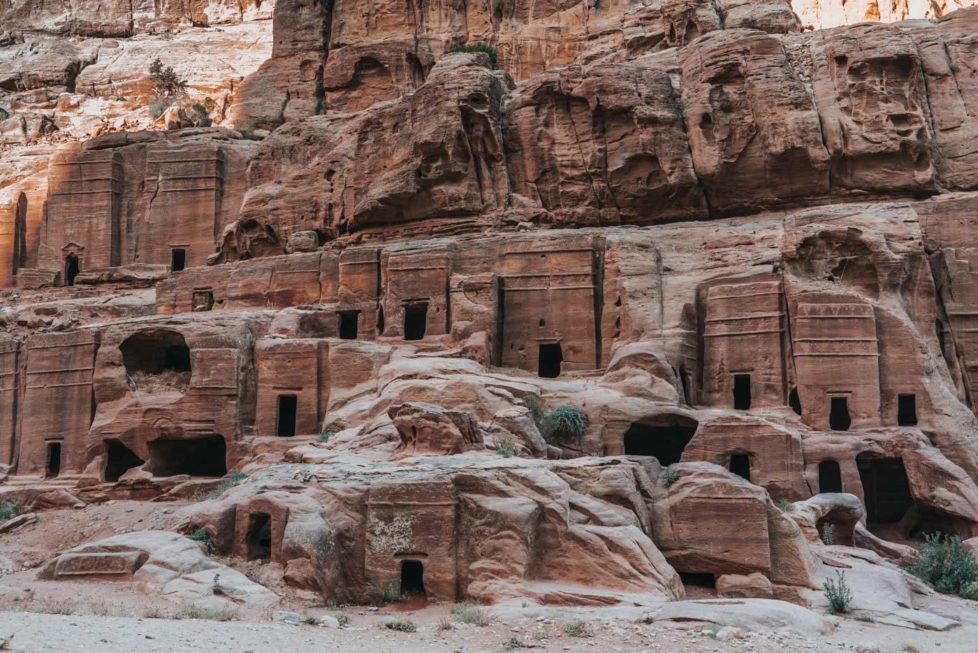 Rock-carved tombs along the main road in Petra, Jordan