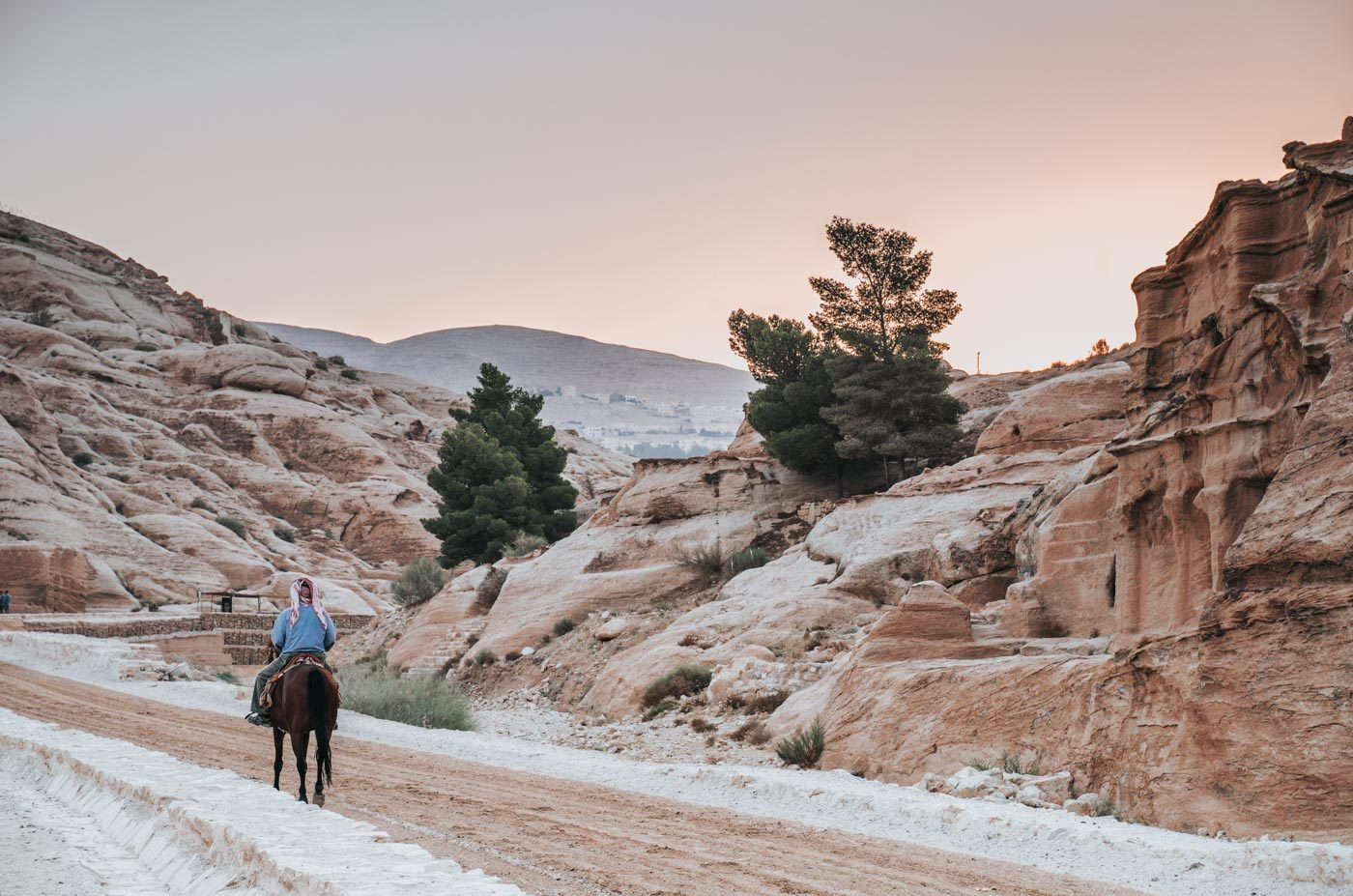 Things to see in Jordan: Bedouin riding a horse in Petra, Jordan