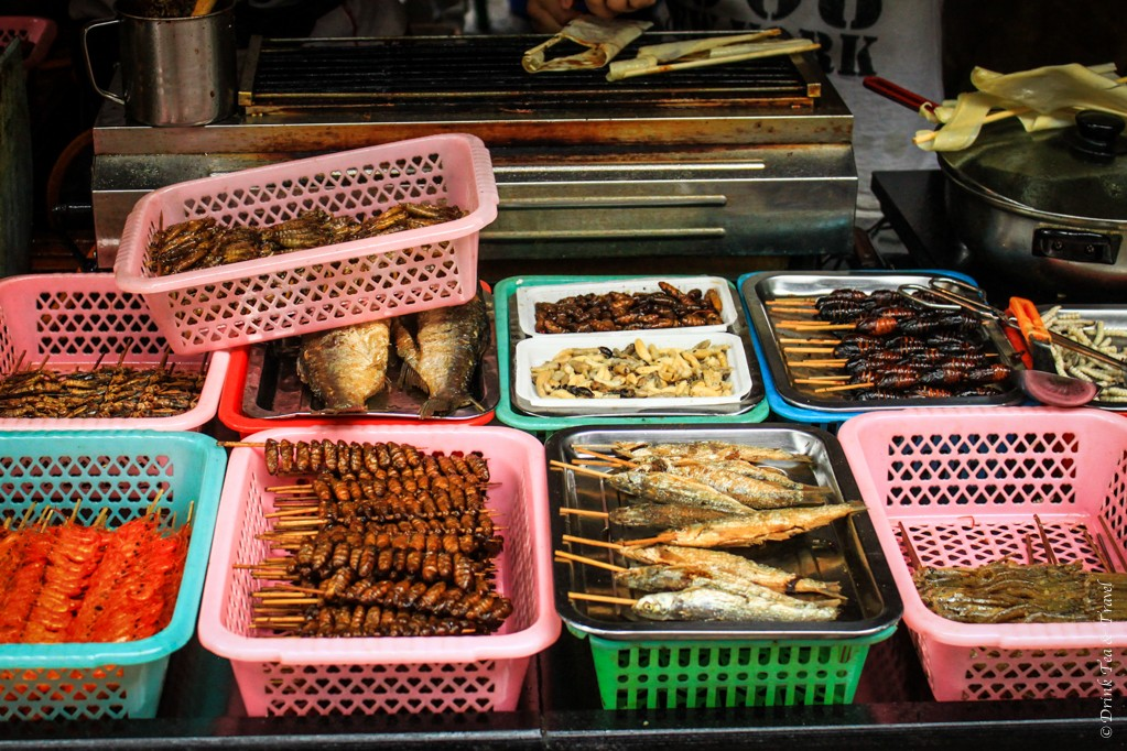 It wouldn't be a food market in China without a stall selling insects. Lijiang, China