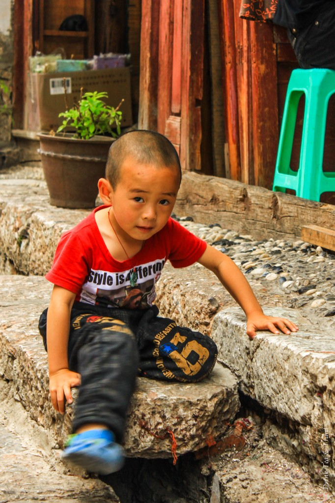 Little boy playing on the streets of Lijiang, China