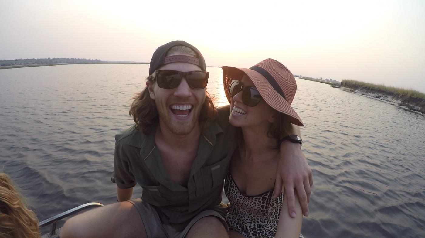 Saving Money for Travel: Couple having fun on boat