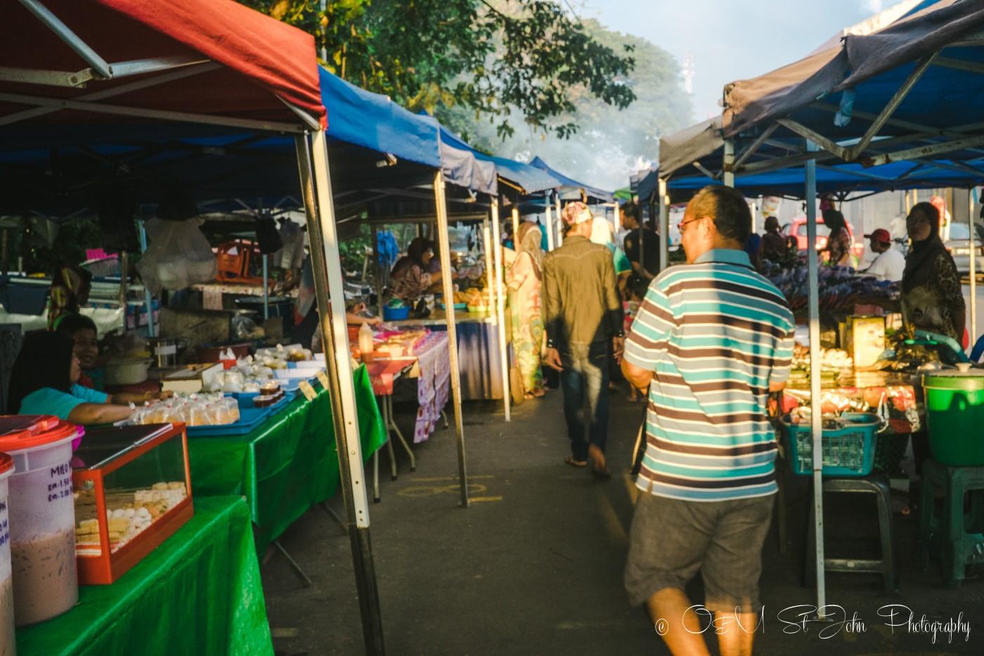 Ismail showing me around the Kota Belud Sunday Market. Sabah. Malaysia
