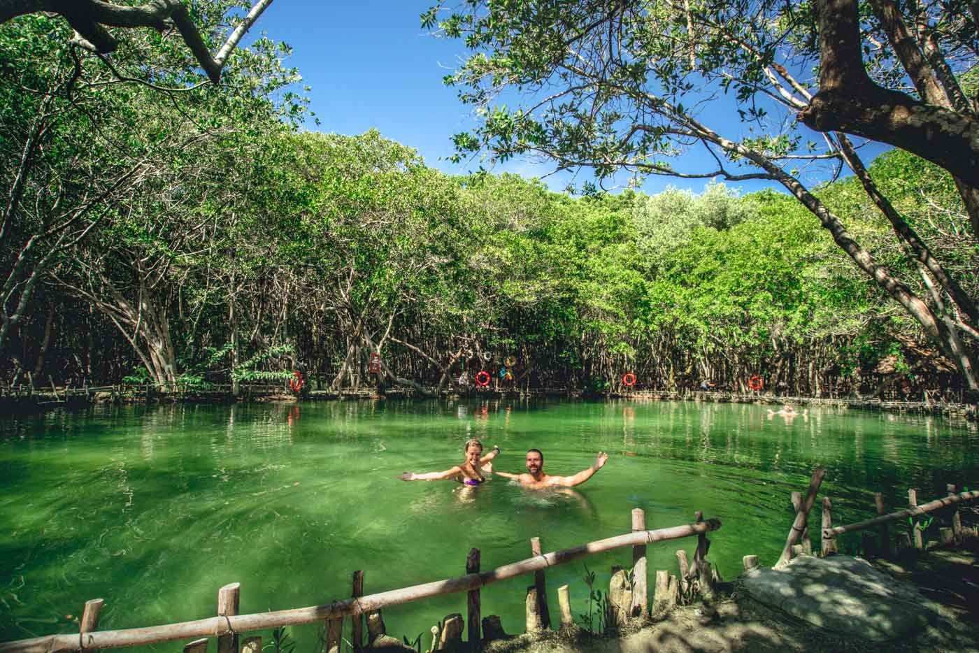 Swimming in a cenote near Progreso, Yucatan, Mexico