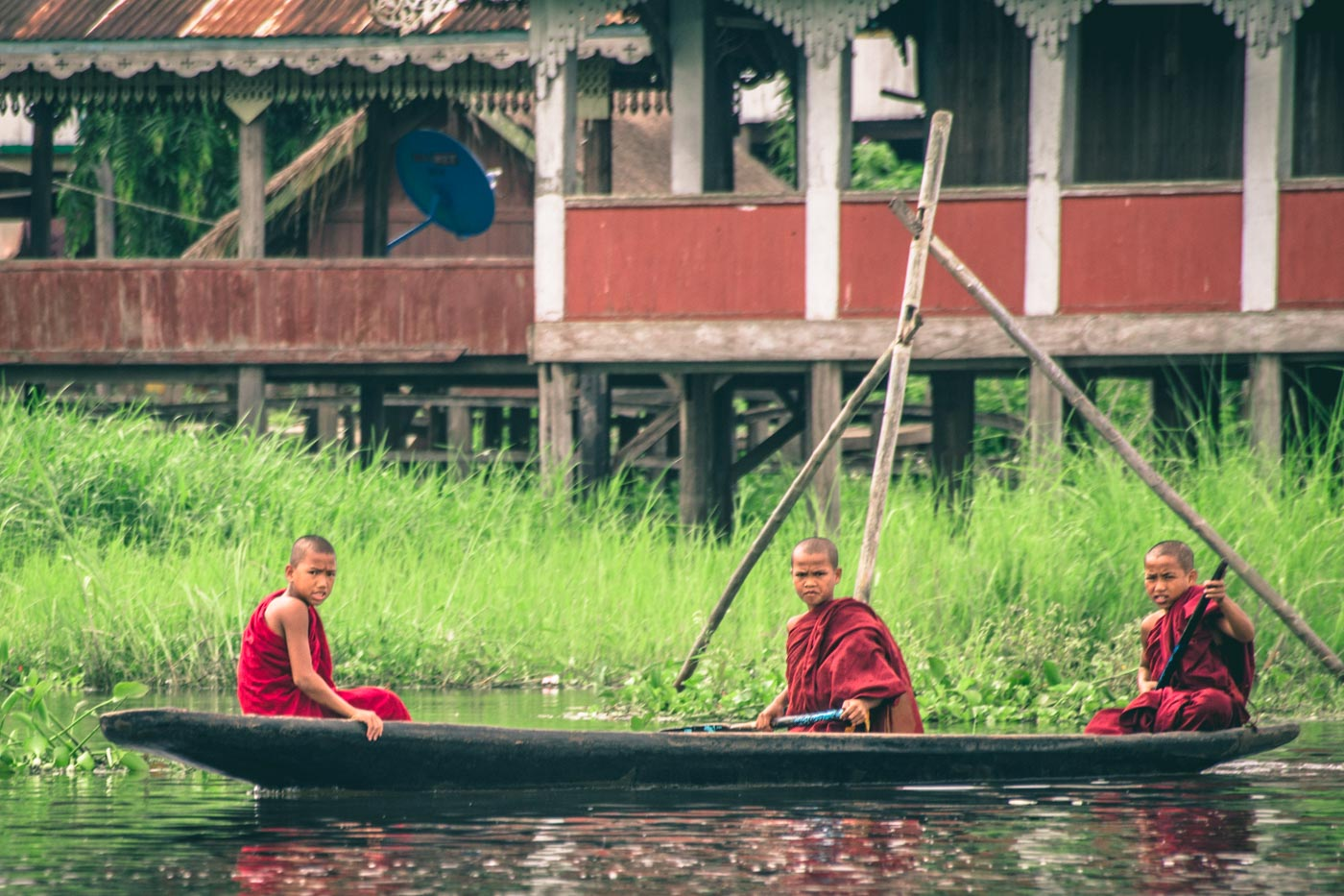 Young Burmese monks making their way across Inle Lake, Myanmar