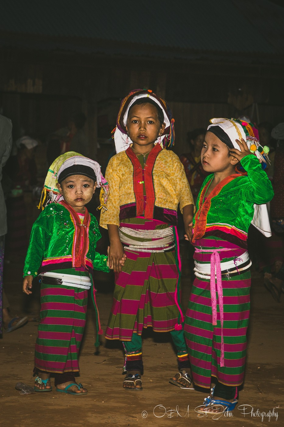 Young girls in traditional outfits at the Palaung VIillage Monk Harvest Festival. Myanmar