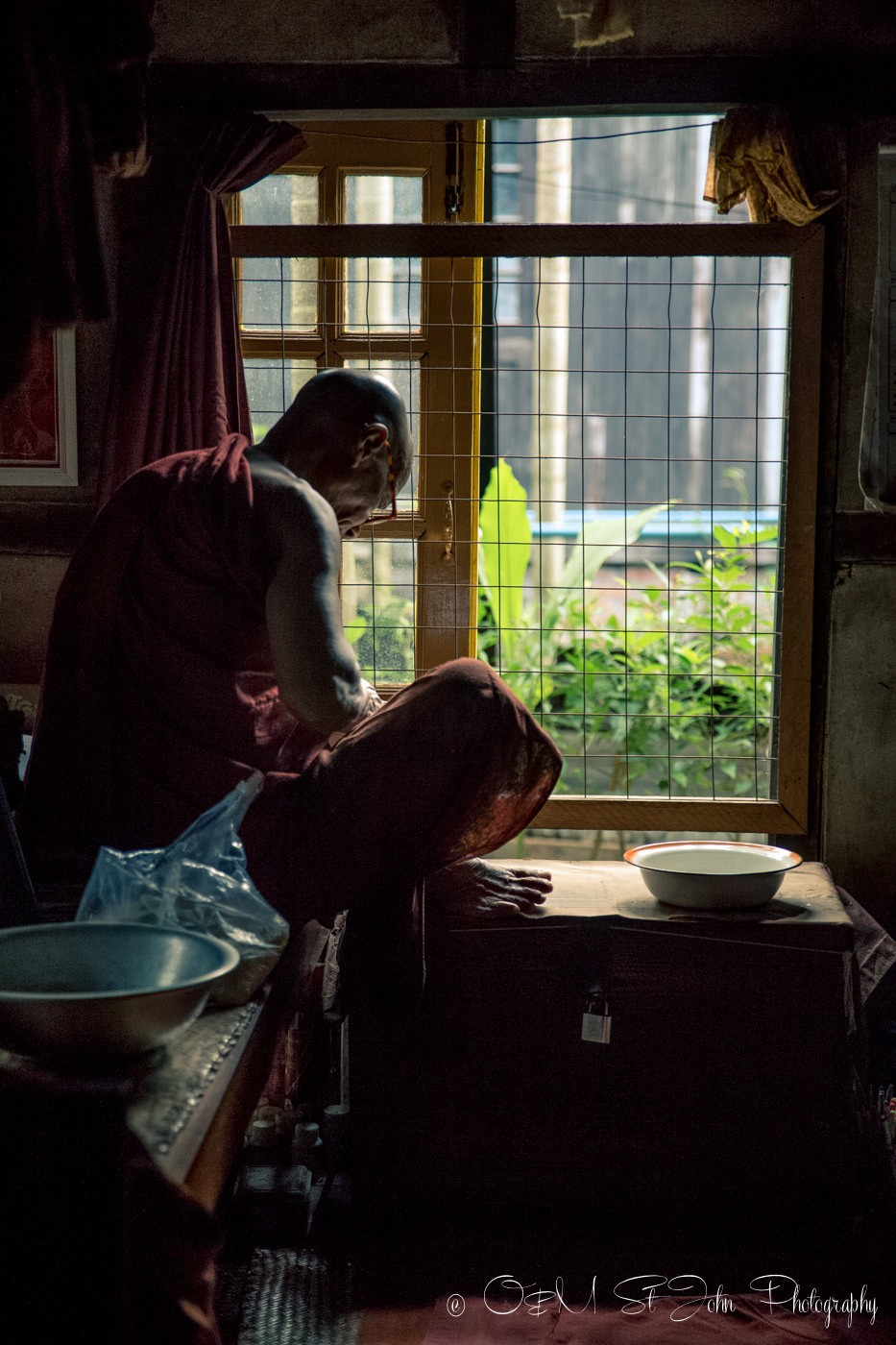 3 days in Yangon: Monk studying in his living quarters at a monastery in Yangon, Myanmar