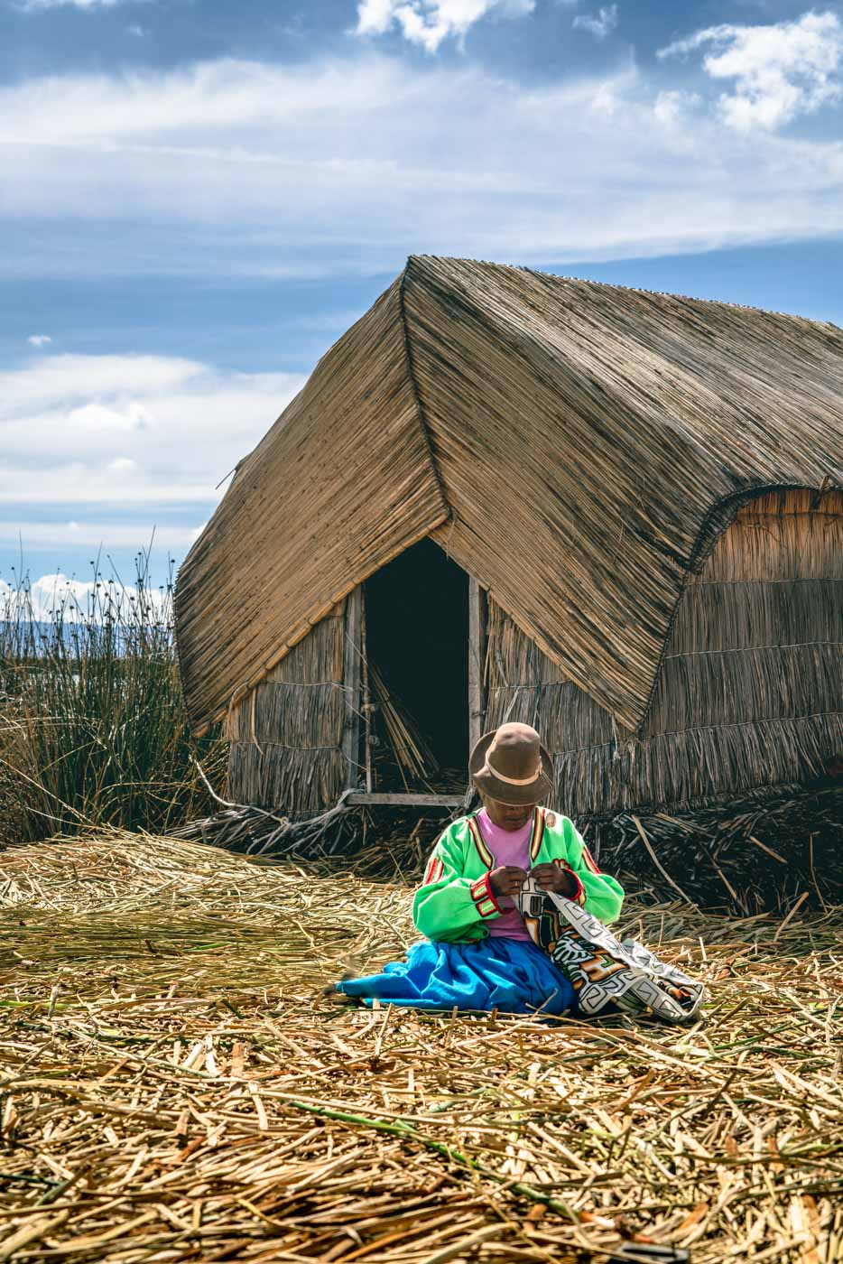 Local woman weaving on Uros Island